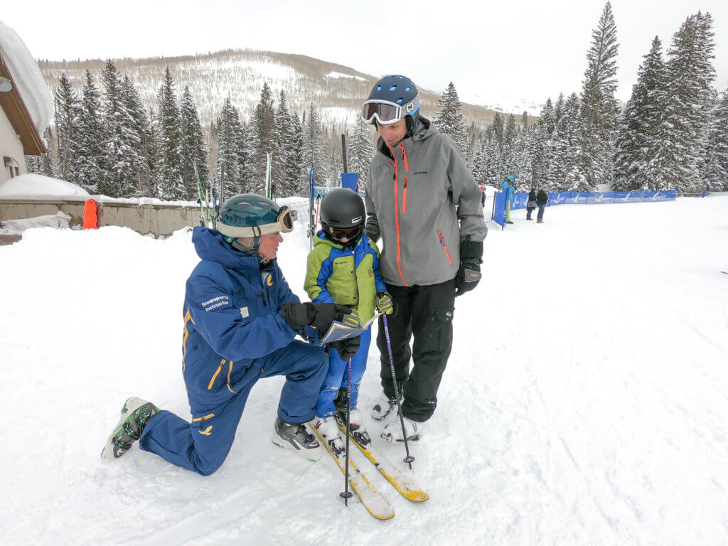 Ski & Ride School instructor with child and parent